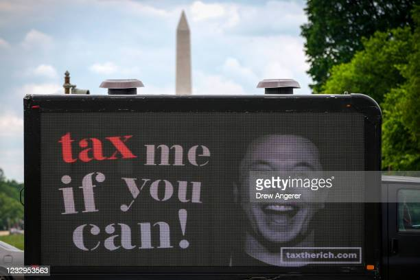 Mobile billboard calling for higher taxes on the ultra-wealthy depicts an image of billionaire businessman Elon Musk, near the U.S. Capitol on May...