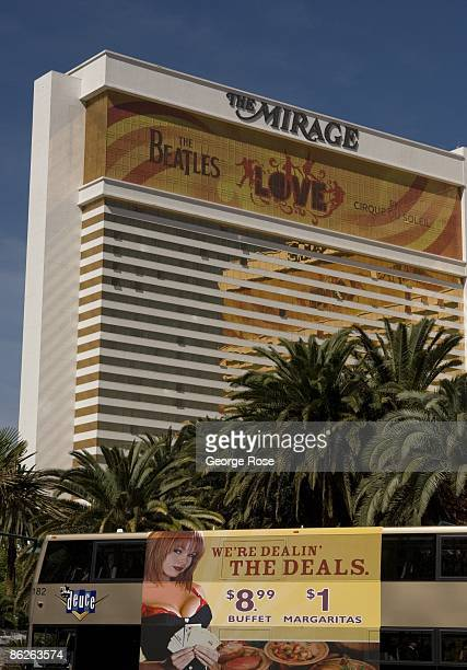 A mobile billboard featuring a Hot Babes escort service drives past the Mirage Hotel Casino on the Las Vegas Strip as seen in this 2009 Las Vegas...