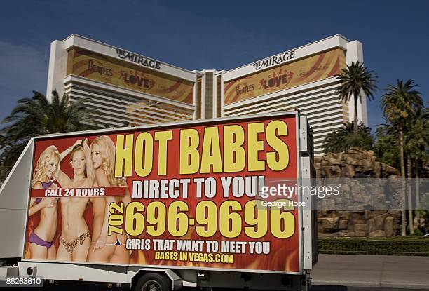 A mobile billboard featuring a 'Hot Babes' escort service drives past the Mirage Hotel Casino on the Las Vegas Strip as seen in this 2009 Las Vegas...