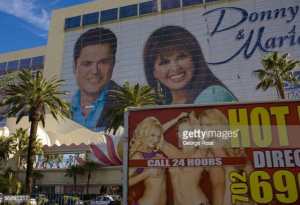 A mobile billboard promoting Hot Babes is seen passing by a billboard promoting the Donny Marie Osmond show at the Flamingo Hotel as seen in this...