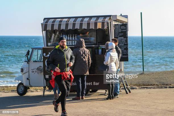 Mobile cafe based on Piaggio Ape moped at the Baltic Sea coast near the Orlowo Cliff is seen on 5 February 2017 in Gdynia Poland