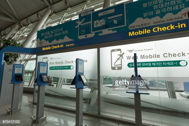 mobile check-in counter in incheon international airport - incheon airport stock photos and pictures