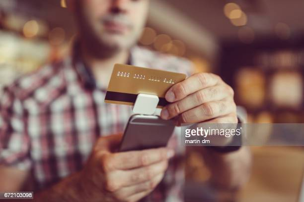 mobile credit card payment - credit card reader stock pictures, royalty-free photos & images