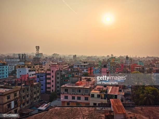 mobile device photo of the surise cityscape of chittagong, bangladesh - bangladesh stock-fotos und bilder