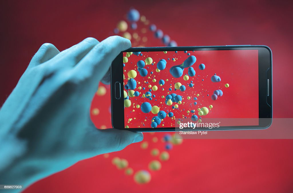 Mobile device taking picture of abstract shape : Stock Photo