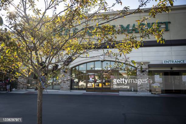 Mobile devices in a tree outside of a Whole Foods store in Evanston, Illinois, U.S., on Saturday, Aug. 29, 2020. A strange phenomenon has emerged...
