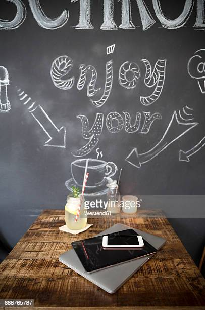 Mobile devices on table in a cafe