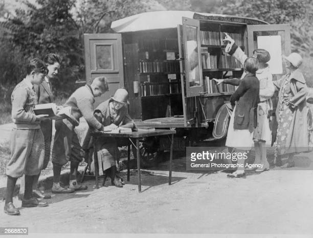 A mobile division of the New York Public Library a library on wheels parks in a street on Staten Island for the locals to browse through its...