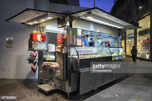mobile food vendor in duomo square,milan. - emreturanphoto stock pictures, royalty-free photos & images
