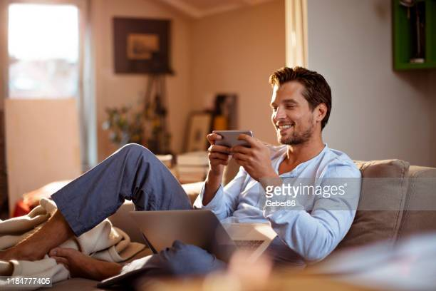 mobile games - mid adult men stock pictures, royalty-free photos & images