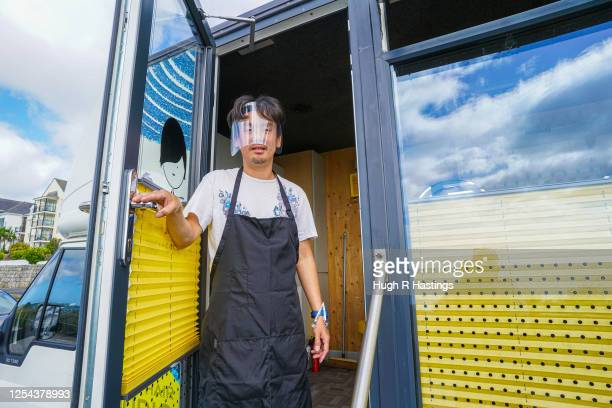 Mobile hairdresser Masaya Shibasaki poses for the photographer as his business resumed operating on the coast road on July 5 2020 in Falmouth United...