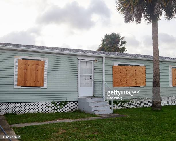 Mobile home protected by plywood stands ahead of Hurricane Dorian in Titusville, Florida, U.S., on Monday, Sept. 2, 2019. Hurricane Dorian is...