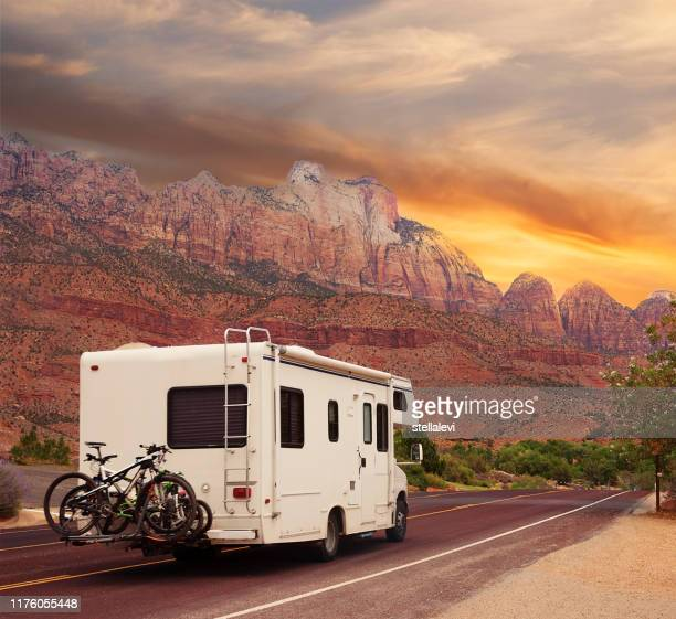 mobile home with bicycles on road trip - stellalevi stock pictures, royalty-free photos & images