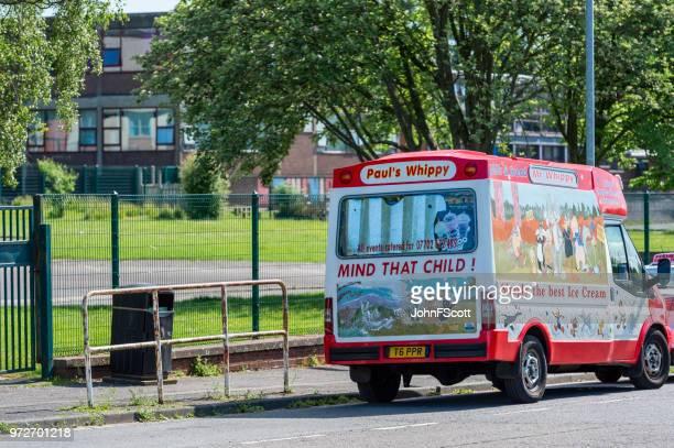 Mobile ice cream van outside a school