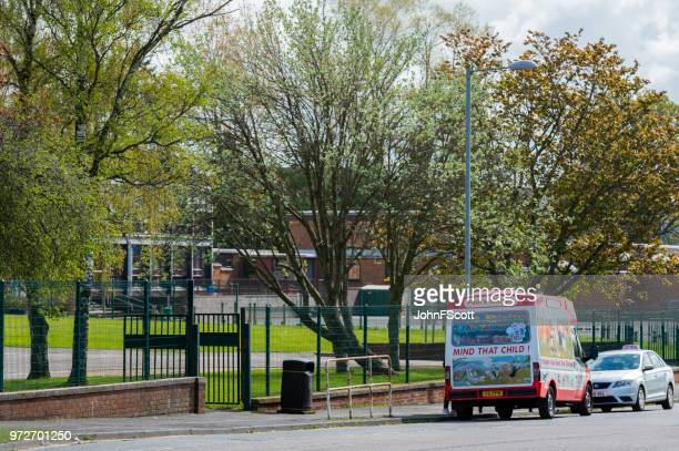 mobile ice cream van outside a school - dumfries stock pictures, royalty-free photos & images