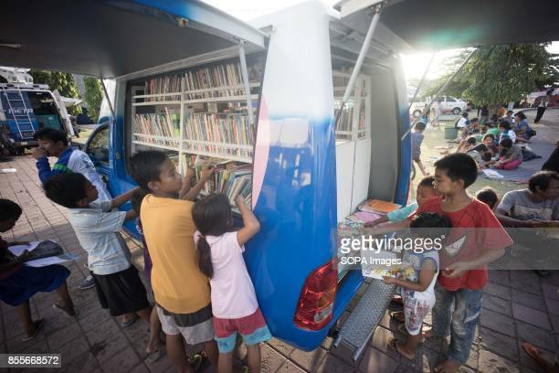 A mobile library provideing book borrowing sevice for the children who are staying in the sport hall which turned into tempoary accomodation for the...