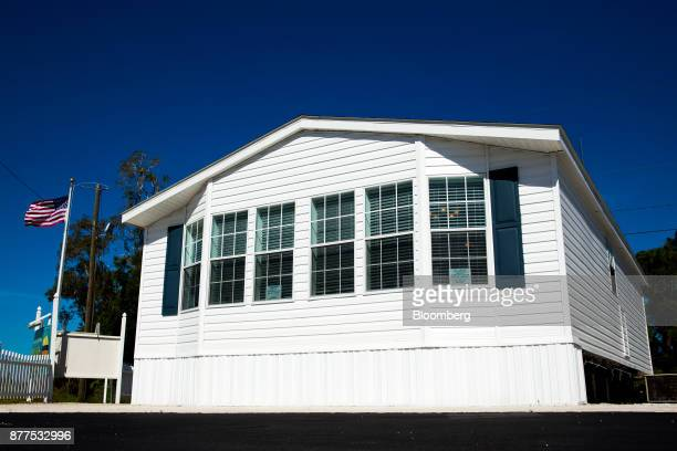 A mobile model home stands at the LeeCorp Homes Inc dealership in Estero Florida US on Tuesday Oct 31 2017 Hurricane victims emerging from ravaged...