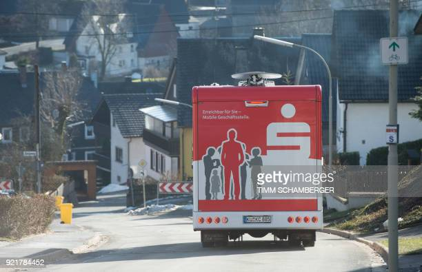 A mobile office bus of the savings bank Sparkasse drives through the village of Tschirn southern Germany on January 30 2018 Bank manager Juergen...