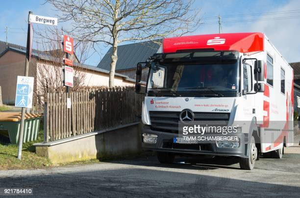 A mobile office bus of the savings bank Sparkasse is parked in Tschirn southern Germany on January 30 2018 Bank manager Juergen Schaller never...