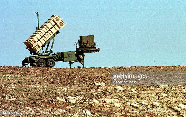 A mobile patriot missile launcher stands with rockets raised in preparation of an Iraqi attack