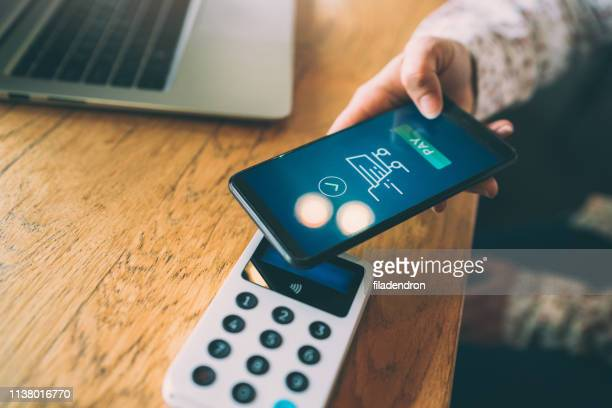 mobile payment - electronics store stock photos and pictures