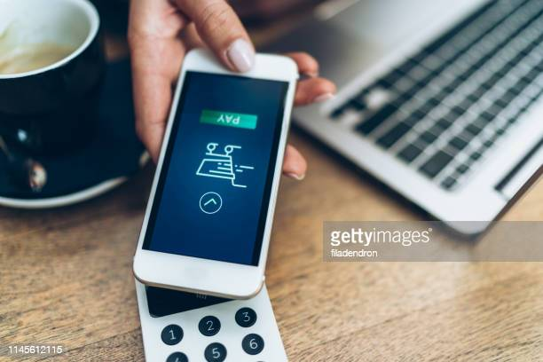 mobile payment - money transfer stock pictures, royalty-free photos & images