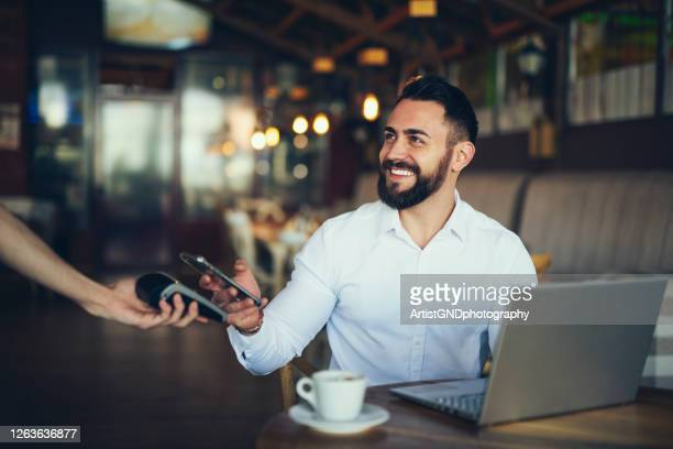 mobile payment - paying stock pictures, royalty-free photos & images