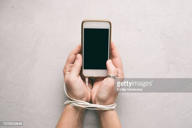 mobile phone addiction - addict stock photos and pictures