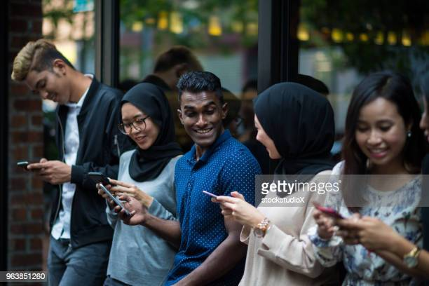 mobile phone addiction - insulting islam stock pictures, royalty-free photos & images