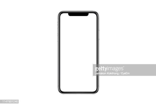 mobile phone against white background - draagbare informatie apparatuur stockfoto's en -beelden