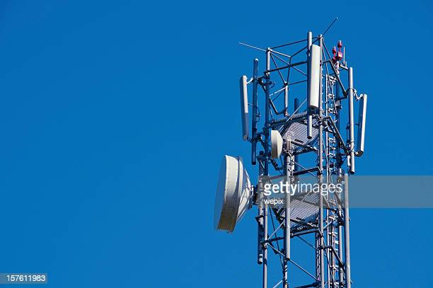 Mobile phone antenna close up against deep blue clear sky