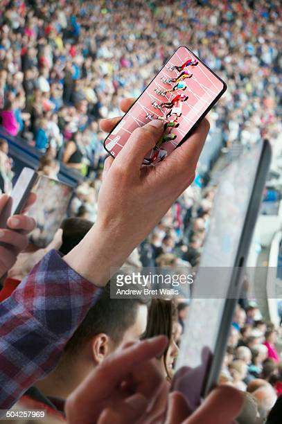 Mobile phone camera zooms in on athletics action