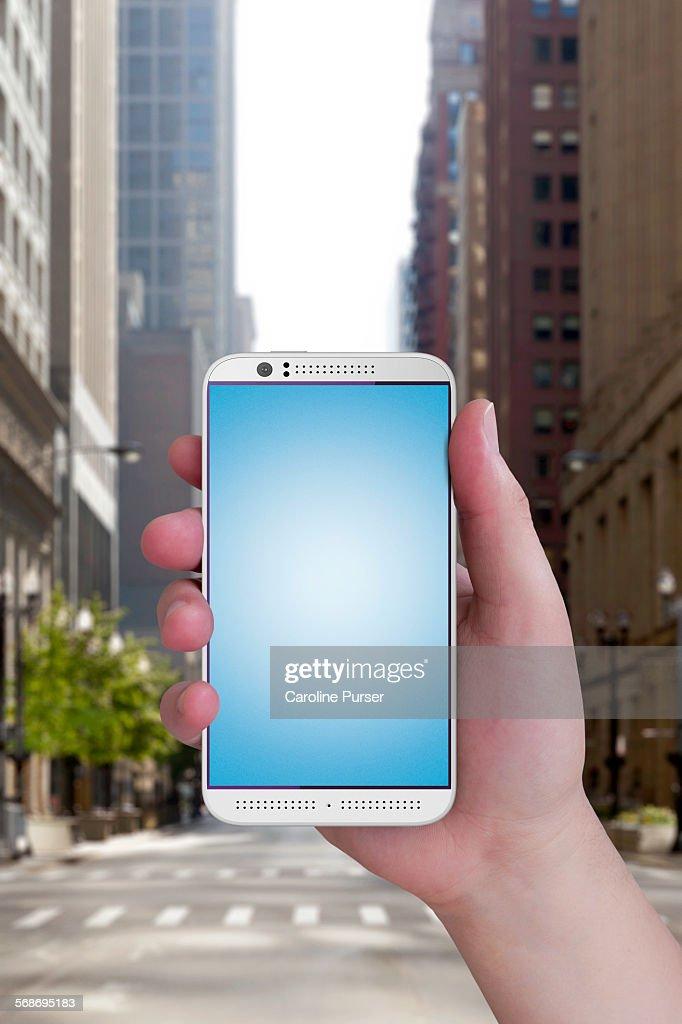 Mobile phone closeup in street : Stock Photo