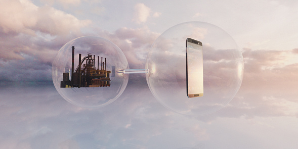 Mobile phone connected to factory both inside floating transparent spheres, technology and pollution concepts - gettyimageskorea