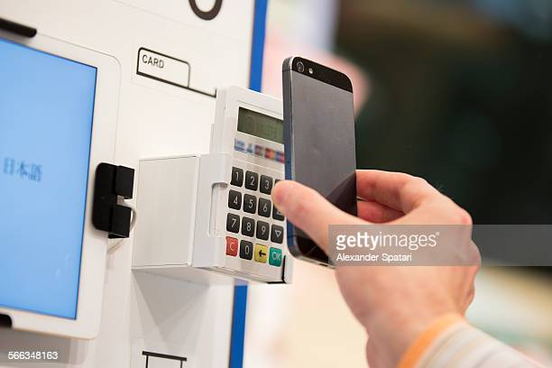 Mobile phone contactless payment in Milan Italy