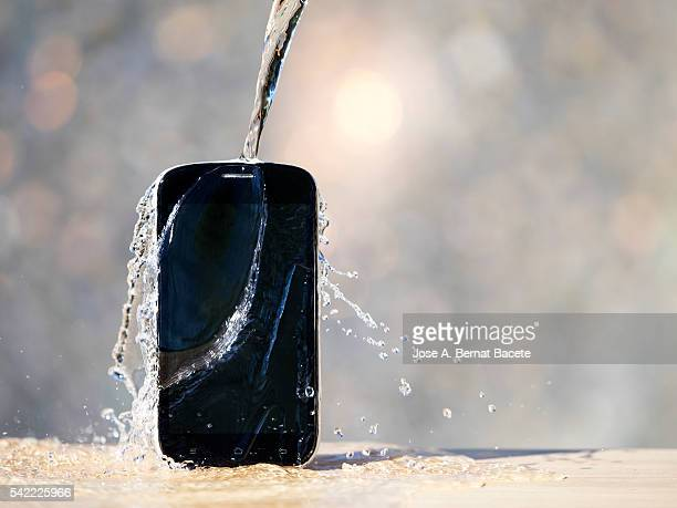 Mobile phone damaged for being under a water jet