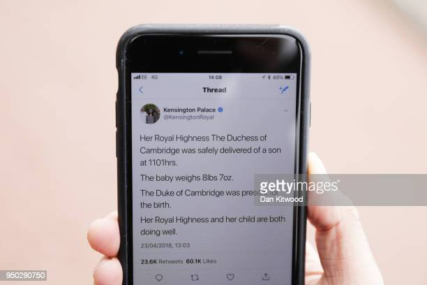 A mobile phone dislays a tweet from the Kensington Palace Twitter account announcing that the Duchess of Cambridge has given birth to a baby boy at...
