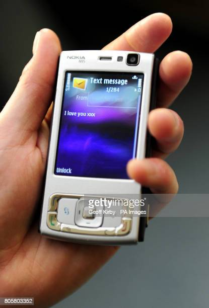 A mobile phone display's the message I love you on the screen