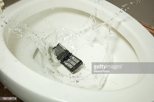 Mobile Phone Drops into a Toilet