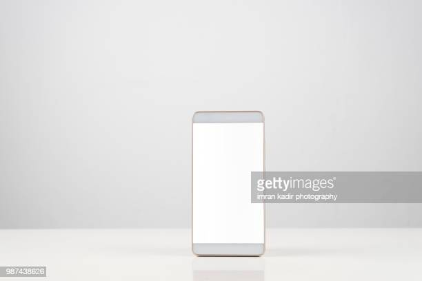 mobile phone in white background - template stock pictures, royalty-free photos & images