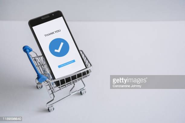 mobile phone inside shopping cart. online shopping concept. - home shopping stock pictures, royalty-free photos & images