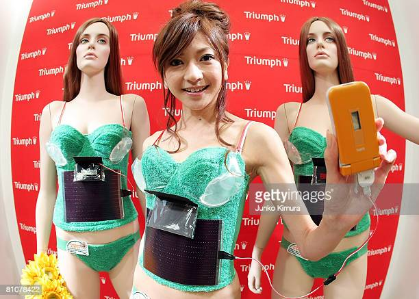 A mobile phone is charged by the lingerie maker Triumph's new environmentfriendly 'PhotovoltaicPowered Bra' at Tokyo Ryutsu Center on May 14 2008 in...