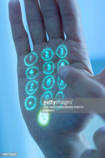 mobile phone keypad projected on hand - projektion stock-fotos und bilder