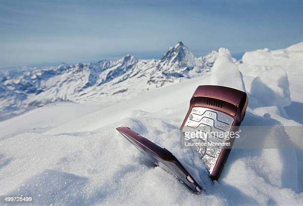 Mobile phone lost in snowy mountains in winter