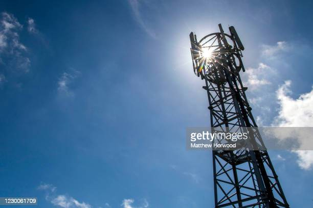 Mobile phone mast silhouetted against a blue sky on May 24, 2020 in Cardiff, United Kingdom. There have been isolated cases of 5G phone masts being...