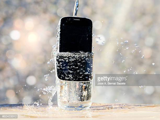 Mobile phone of last generation, resistant to the water inside a water glass