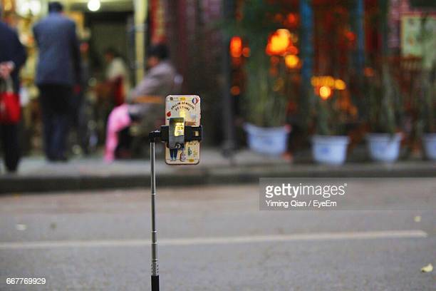 Mobile Phone On Monopod By Street