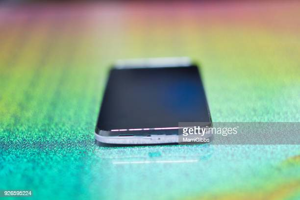 Mobile phone on the colorful desk