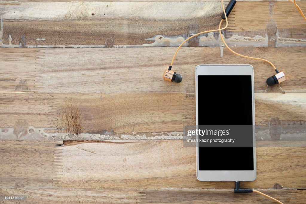 Mobile phone on wooden table. : Stock Photo