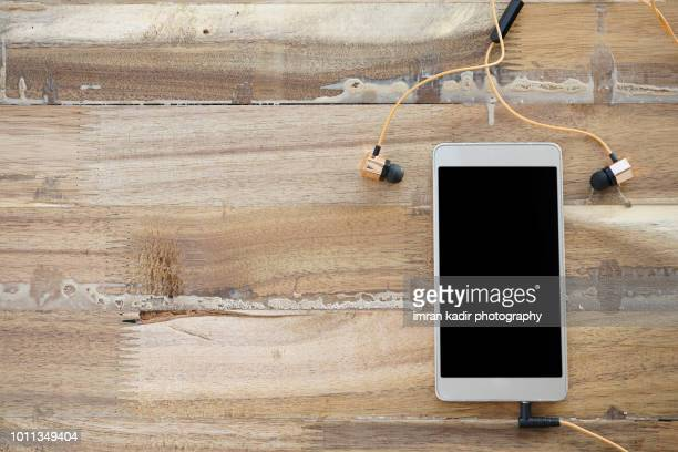 mobile phone on wooden table. - wood table top stock photos and pictures